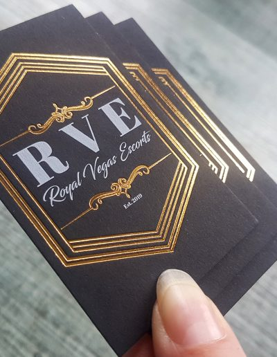 White toner print + gold foil on Royal Vegas Escorts business cards