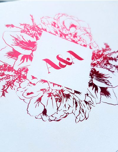 Intricate red foil monogram on NZ wedding invites