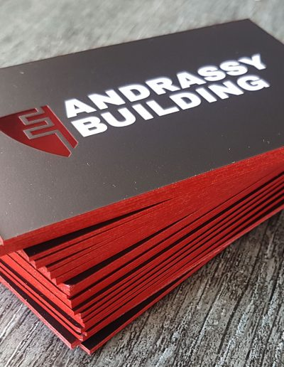 Thick business cards with red edges and red foil stamped logo