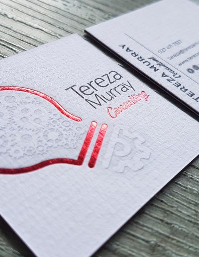 Red foil stamped logo onto a thick, 3 layer sandwiched business card