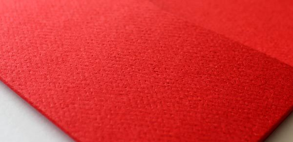 Close up showing textured red card finish