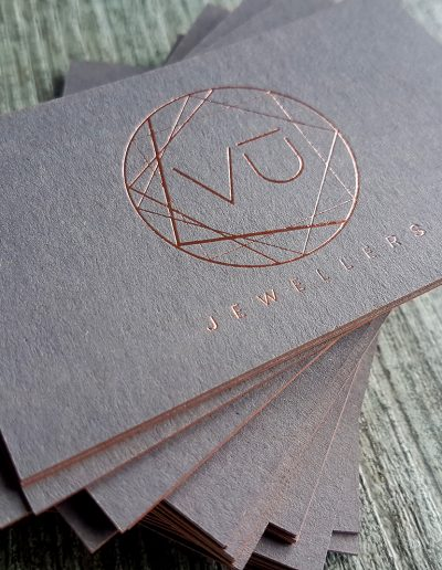 Blush foil stamp on a pulpy, raw charcoal coloured card stock