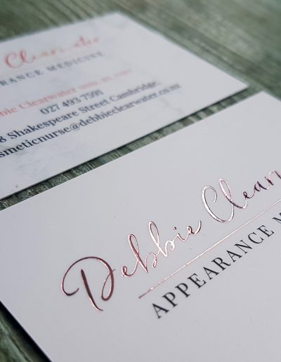 Rose gold foil on business cards with marble background print
