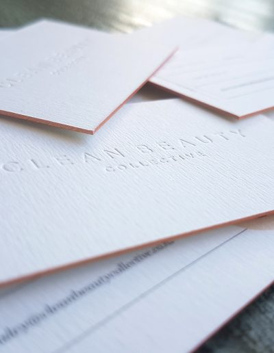 Rose gold edges on thick, debossed business cards