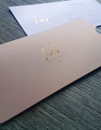 Rose gold sleeves customised with gold foil stamped logo