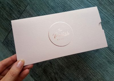 Rose gold custom branded DLE sleeves for gift voucher presentation
