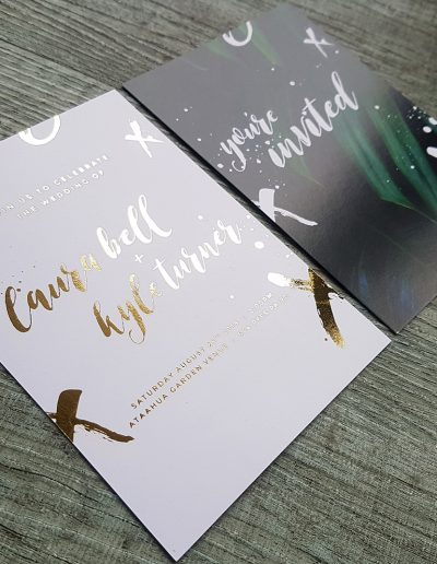Rustic brush script elements on these modern wedding invitations