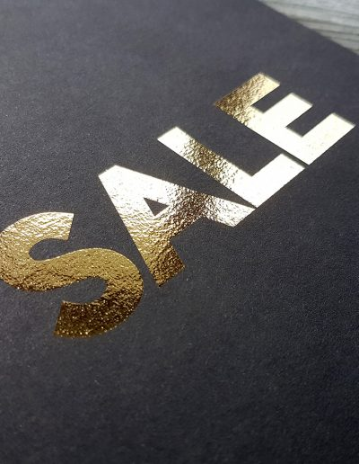 Gold digital foil on a black card stock