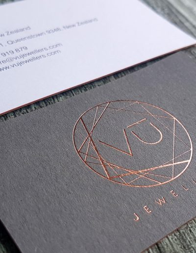 Sandwiched business cards - charcoal with rose gold foil and white with digital print