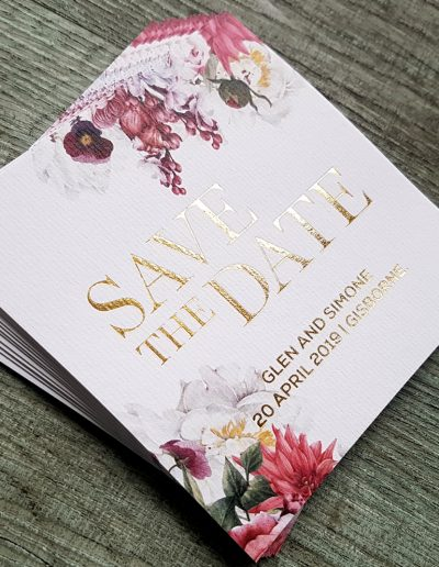 Save The Date cards with lovely floral pattern printed on textured white