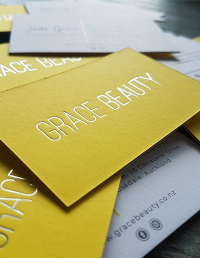 Silver foil on bright yellow business cards, Auckland