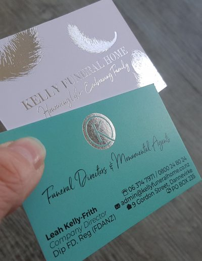 Double sided silver foil stamps on thick teal + white business cards