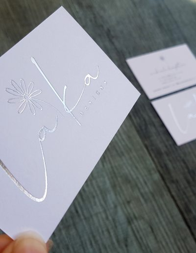 Silver foil stamped logo on Laika Designs' business cards