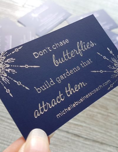 Silver foil pressed onto navy card