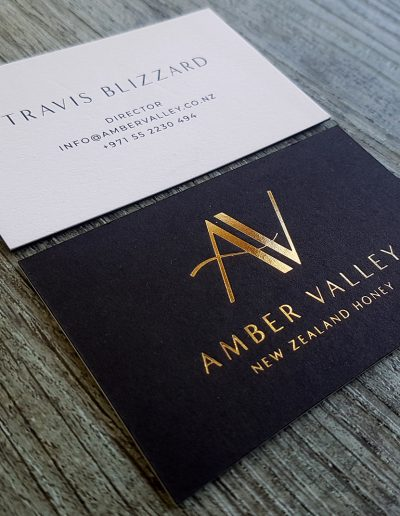 Ultra thick black and white layered business card with gold foil logo