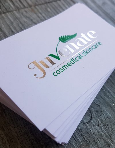 Silver foil stamp for Juvenate business cards printed on a smooth white quality card stock