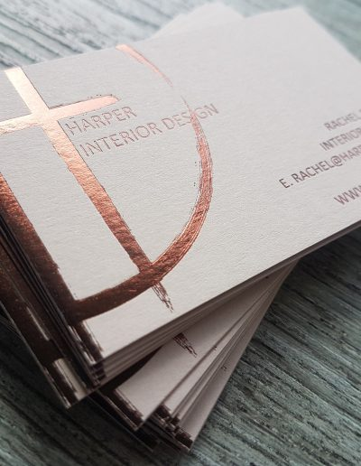 Bronze foil print onto a light grey business card