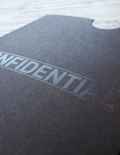 "Sleeve branded with ""confidential"" for a New Zealand business promotion"