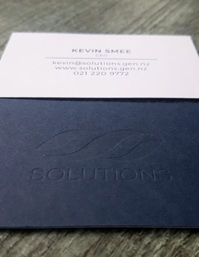 Solutions business cards, navy and white