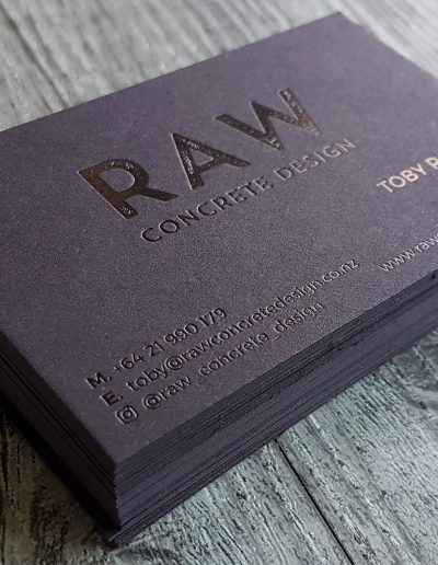 Gloss black foil stamp on thick black business cards, designed and printed in house at Pinc