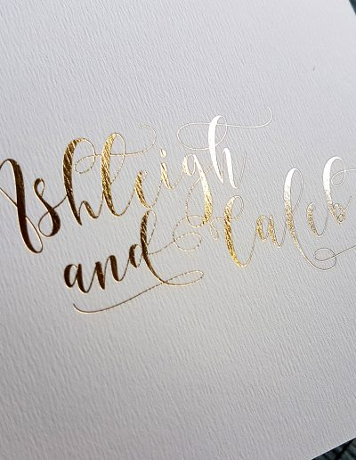 Beautiful font in gold foil on the front of this wedding invitation cover, designed by Pinc