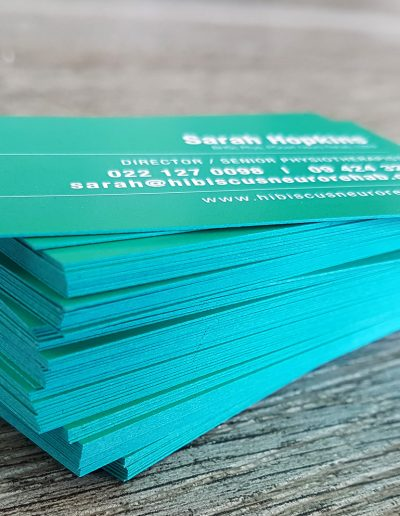 Teal coloured edges on business cards