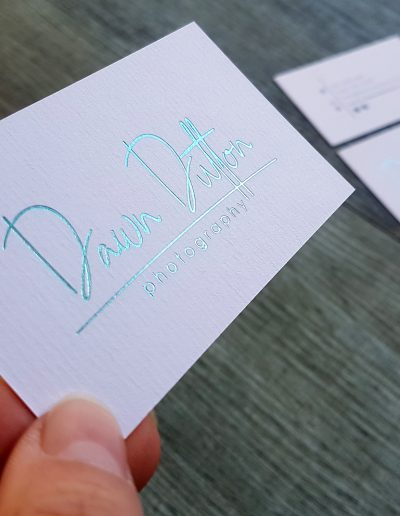 Teal foil stamped logo on Dawn Dutton Photography business cards