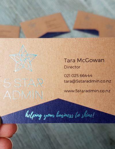 Teal foil stamped business cards on kraft