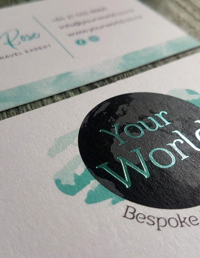 Teal foil stamp on Your World logo, printed on metallic white card - business cards designed in house at Pinc