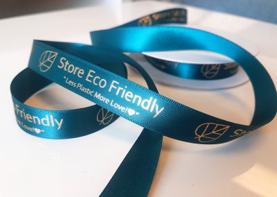 Gold and teal branded ribbons