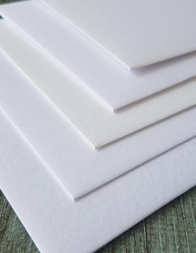 textured white envelope ranges