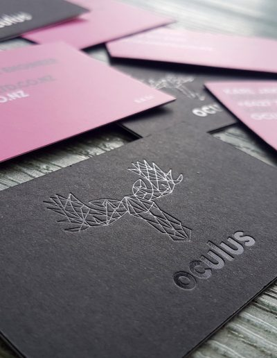 Thick 3 layer business cards with gloss black logo pressed in
