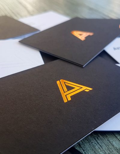 Ultra thick duplexed business cards, black + white with copper foil