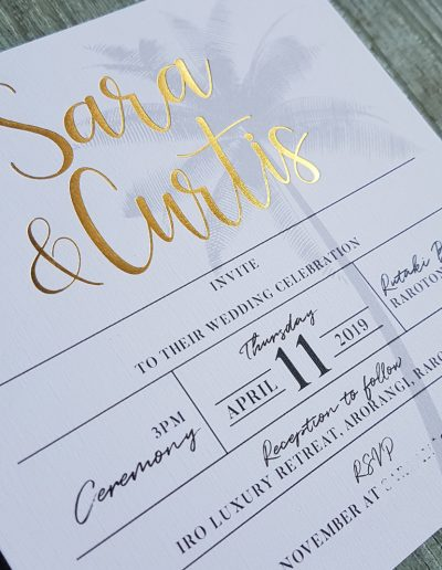 Gold foil names on tropical wedding invitation design