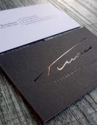 Gloss black foil stamped logo for NZ photographer, on matt black card sandwiched with white card