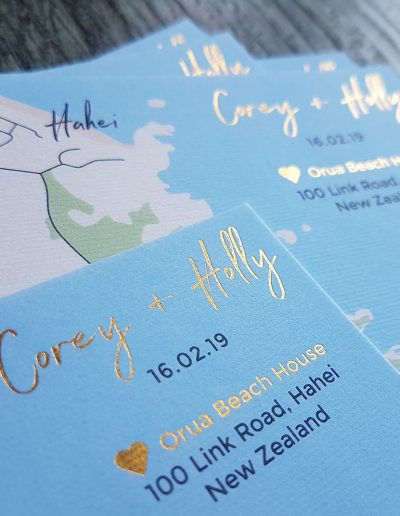 Close up of gold foil names on NZ wedding invitation info card
