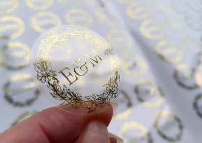 Bride & groom's initials printed in gold on clear stickers, designed by Pinc