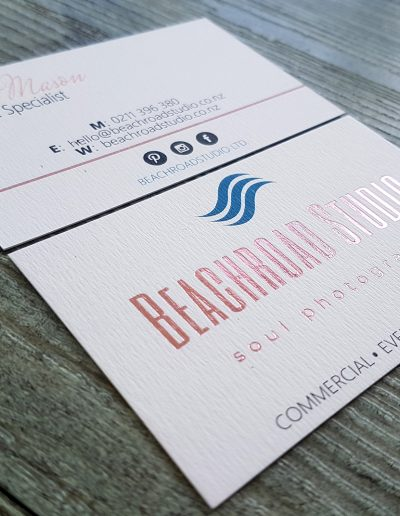 Rose gold foil stamped on to a textured white card stock