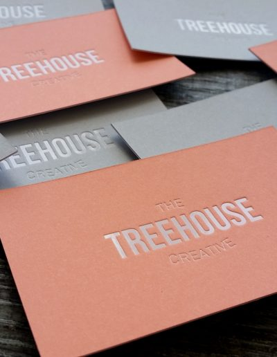 White foil stamped on grey and salmon coloured cards