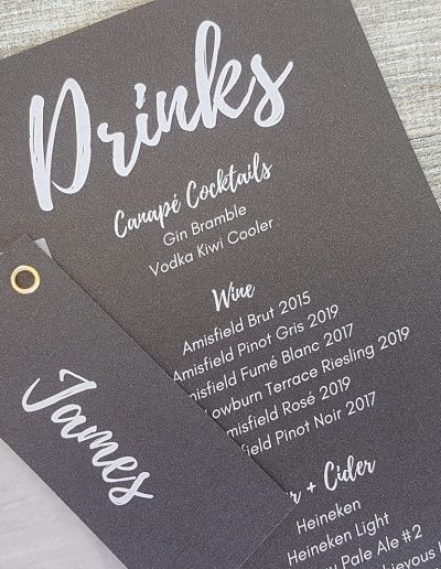 White printed text on a metallic black card for wedding reception stationery