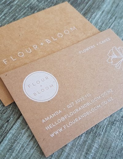 Business cards with white print on kraft card