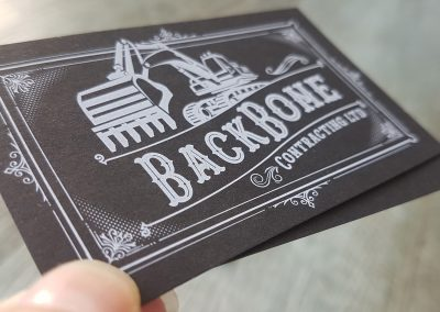 Business cards with white print on black card