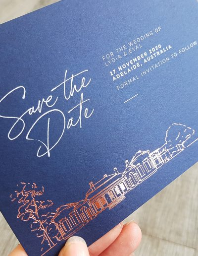 White printed text + rose gold foil on a navy card stock
