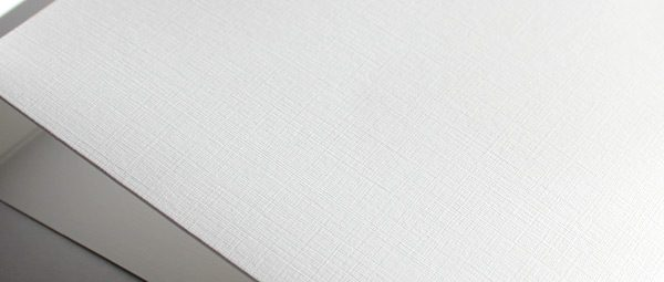 White linen embossed card stock close up