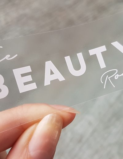 White toner printed onto clear labels for The Beauty Room