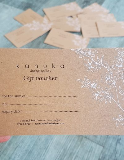 Gift voucher with white print and colour printing on kraft card