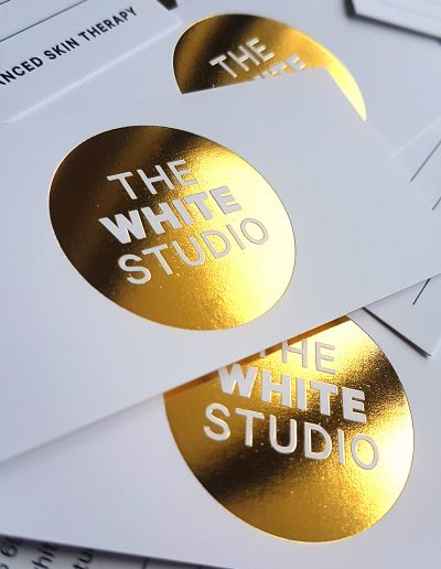 Solid gold foil stamped logo for New Zealand skin therapists, The White Studio