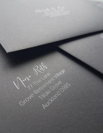 white print on black envelopes