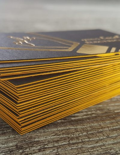 Yellow coloured edges on thick, sandwiched black + white business cards